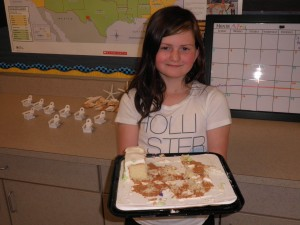Jenna, the student who wrote our 1,000th comment, holding what was left of our cake!