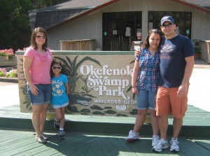 In front of the Okefenokee sign